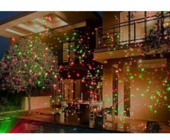 Звездный лазерный проектор снаружи дома